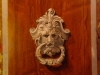 trompe door knocker with wood grained background